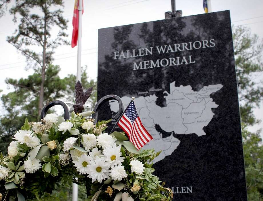 The names of more than 634 fallen Texas men and women were called at the Silent Roll Call hosted by National Memorial Ladies. Photo: Minza Khan