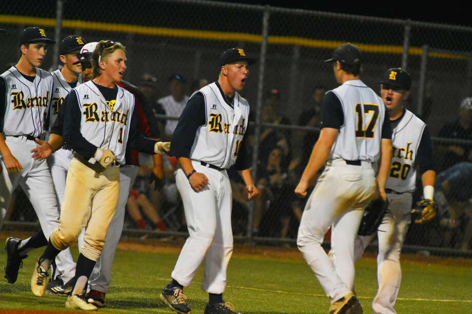 Cypress Ranch senior pitcher Tyler Bielamowicz enjoys some praise from his teammates for his performance in Friday's 3-0 game two win against Langham Creek. Bielamowicz pitched five innings of shutout ball before allowing the game's only hit in the bottom of the sixth inning. Photo: Tony Gaines