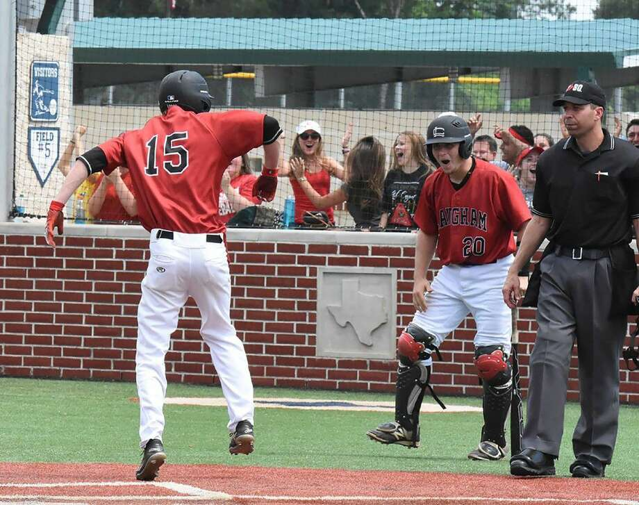 Langham Creek baseball players John Michael Sopher (15) and Mikey Hoehner celebrate after Sopher scores a run in the Lobos' 8-6 Game 3 win over Cypress Ranch in a best-of-three quarterfinal playoff series on May 21 at Premier Baseball of Texas.