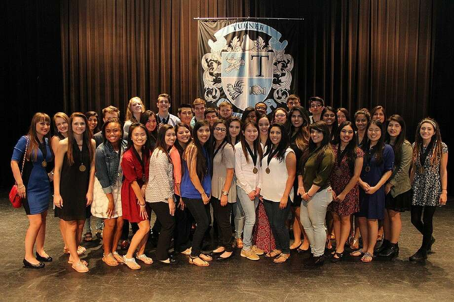 The Dual Degree graduates from ACC at Turner High School pose for a photo at a ceremony on May 13.