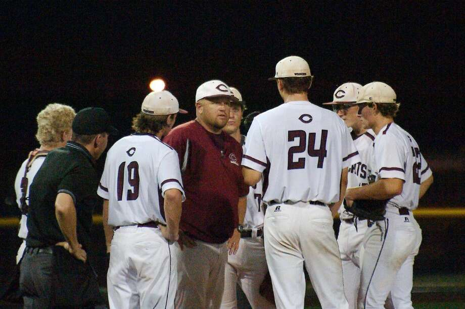 Clear Creek baseball coach Brent Kunefke speaks to players during the Wildcats' doubleheader with Pearland Friday. Photo: Kirk Sides