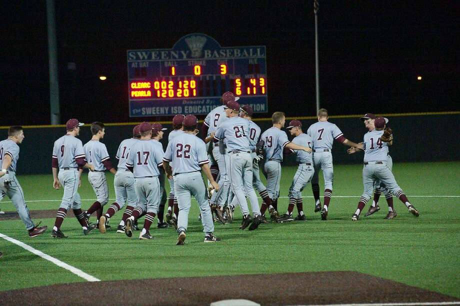 Pearland players celebrate after the final out of their doubleheader sweep of Clear Creek Friday in Sweeny. Photo: Kirk Sides