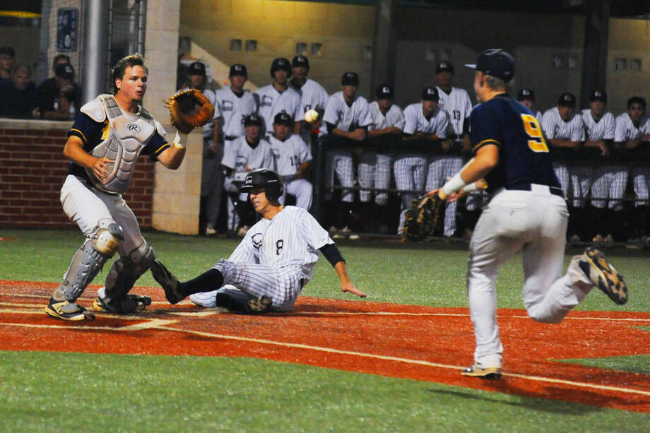 Langham Creek pitcher Brady Perez scores on the squeeze play from left fielder Korey Holland to give the Lobos a 3-2 lead. It would prove to be the game-winning run, as Langham takes a 1-0 lead in the best-of-three series against the district-rival Mustangs. Photo: Tony Gaines