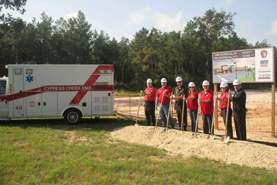 Paramedics with Cypress Creek EMS join ESD 11 representatives Kevin Brost, Lynn LeBouef, Karen Plummer and Fred Grundmeyer, and Cypress Creek EMS Director Brad England at the groundbreaking of the new fire station. Photo: James Singleton