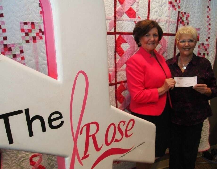 Caption: Donna Conners, organizer of The Luci Bonneau Memorial Striking Against Breast Cancer Mixed Doubles Tournament presents a $10,000 check to Dorothy Gibbons, CEO of The Rose. Photo: Submitted Photo