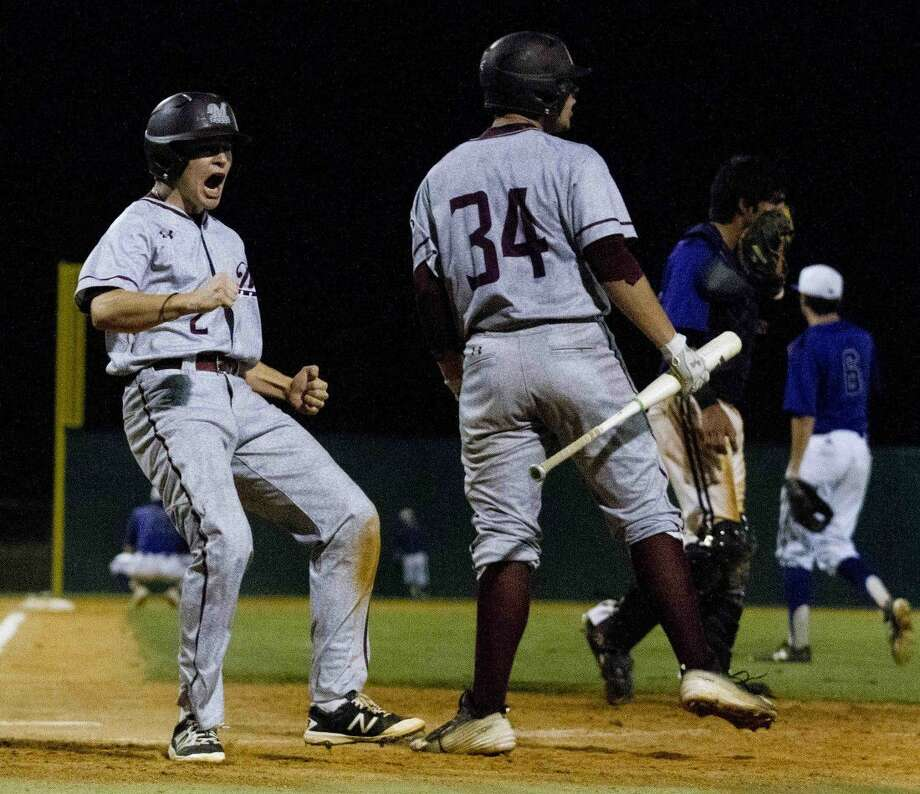 Magnolia's Grant Lee celebrates after scoring on a throwing error at third to break a 2-2 tie in the top of the seventh inning of a Region III-5A area baseball series Thursday in Montgomery. Go to HCNpics.com purchase this photos and other like it.