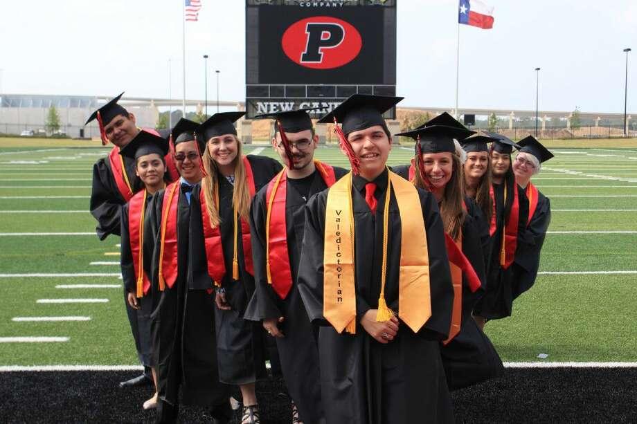 The top ten Porter High School graduates for 2016 pose at Texan Drive Stadium.