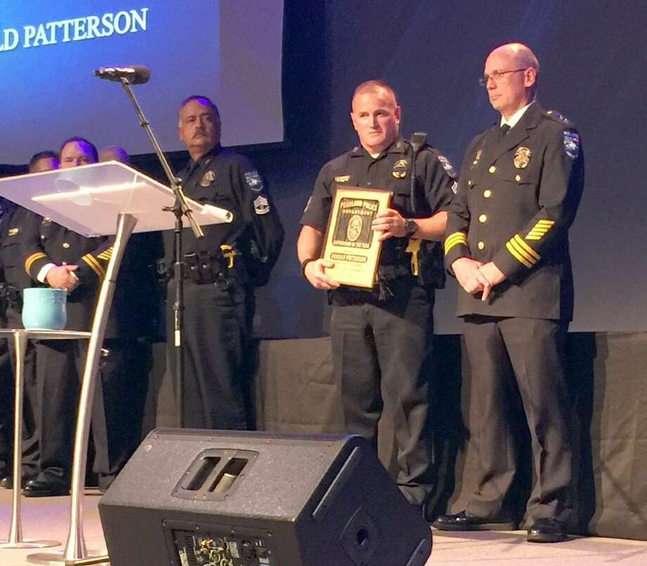 Assistant Chief Johnny Spires (right) presents Sergeant Donald Patterson with an award for Supervisor of the Year. Photo: Kristi Nix