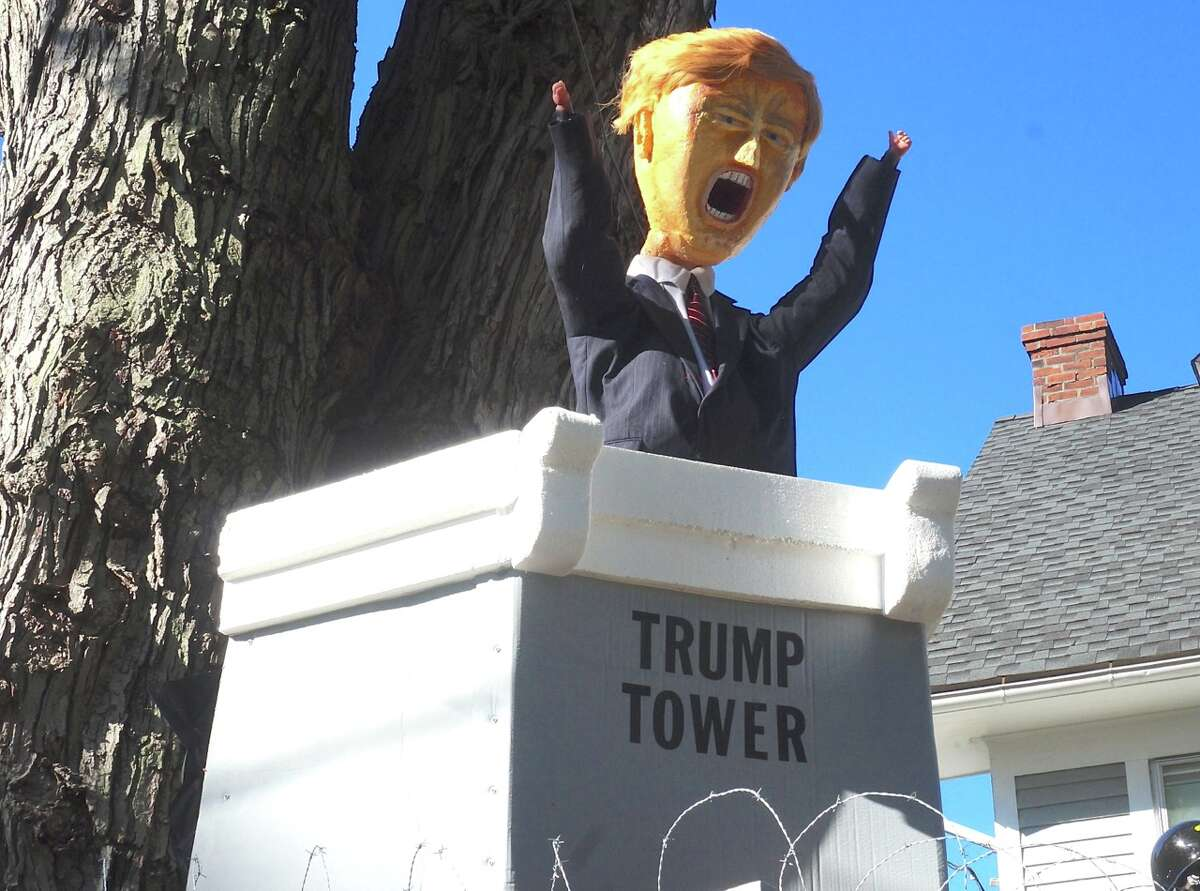 """The West Hartford home of Matthew Warshauer depicts a """"Trump Wall"""" this Halloween, a jab at presidential candidate Donald Trump's promise to have a wall built along the U.S.-Mexico border. The display also pokes fun at Senator Bernie Sanders and presidential candidate Hillary Clinton. (Photo: Ronni Newton, we-ha.com)"""