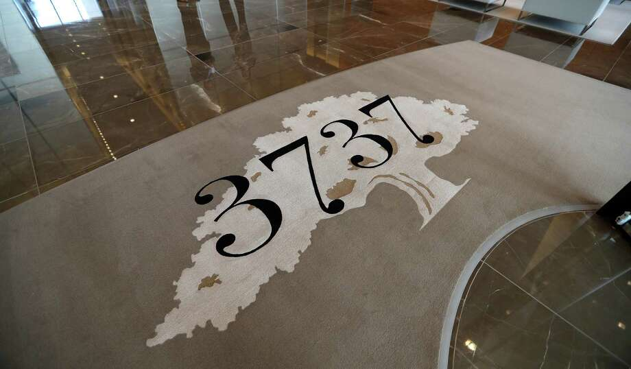 A rug with the 3737 logo in PMRG's new office tower at 3737 Buffalo Speedway, Wednesday, Oct. 5, 2016 in Houston. Photo: Karen Warren, Houston Chronicle / 2016 Houston Chronicle