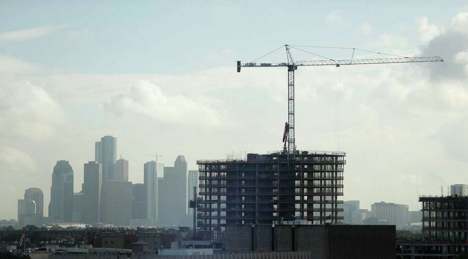 A high-rise building being built near PMRG's new office tower at 3737 Buffalo Speedway, with downtown buildings in the background, Wednesday, Oct. 5, 2016 in Houston. Photo: Karen Warren, Houston Chronicle / 2016 Houston Chronicle