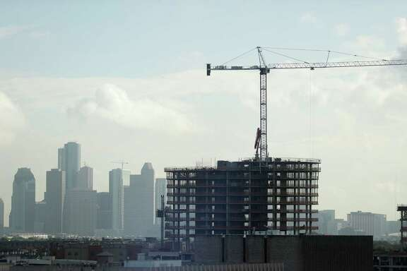 A high-rise building being built near PMRG's new office tower at 3737 Buffalo Speedway, with downtown buildings in the background, Wednesday, Oct. 5, 2016 in Houston.