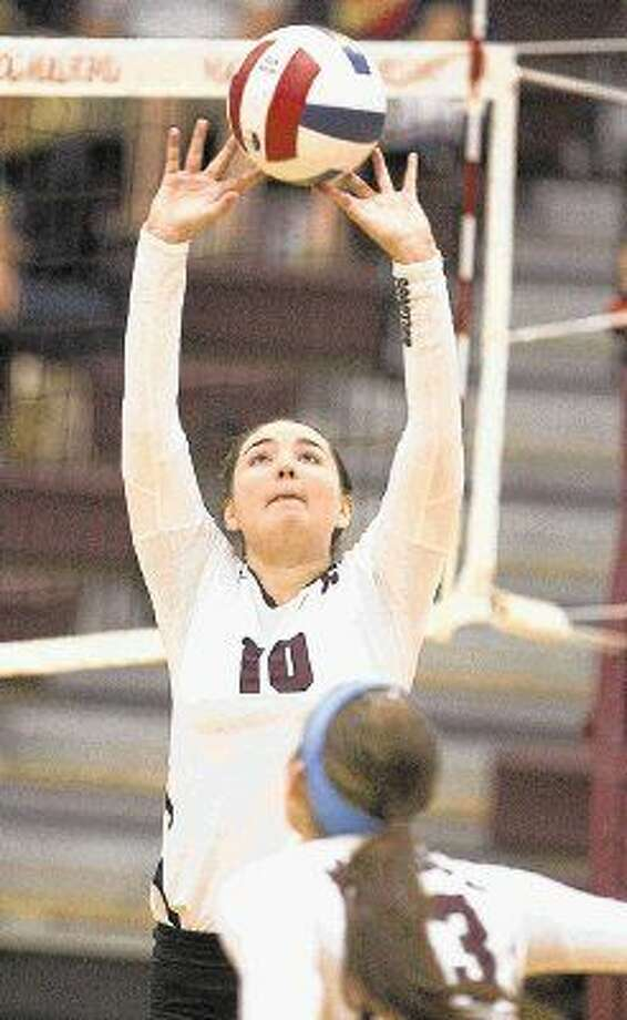 Magnolia's Lindsey Smothers sets up the offense during a game at the Magnolia Volley Battle at Magnolia High School Thursday. To view or purchase this photo and others like it, visit HCNpics.com. Photo: Jason Fochtman