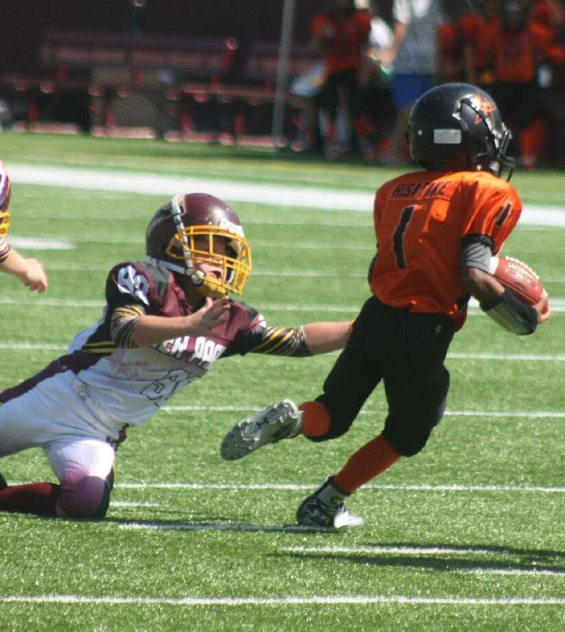 La Porte Cowboy Caden Hisatake eludes one Deer Park Ram defender as he begins his coast-to-coast scamper to the opposite end zone, 99 yards away during Saturday's victory for the visitors. Hisatake scored three TDs on the day, finishing with over 200 yards rushing. Photo: Robert Avery