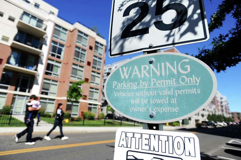 "The ""permit only"" parking signs on Old Yale Place and elsewhere in Harbor Point has caused confusion for motorists. Photo: Michael Cummo / Hearst Connecticut Media / Stamford Advocate"
