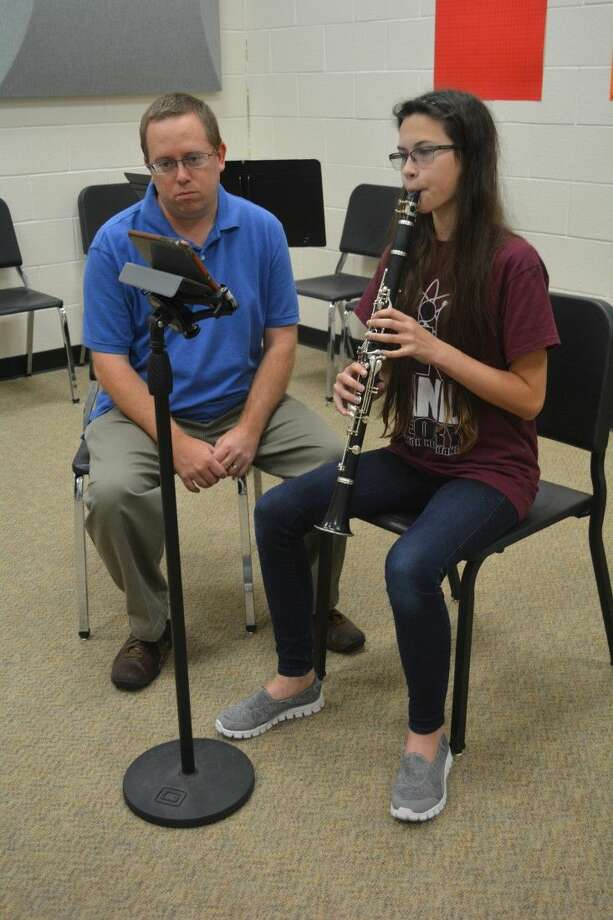 Beck Junior High band director Brenden Steber works with a student using the Music Prodigy Tool. The tool can be used on a computer, tablet or smart phone for the user's convenience.