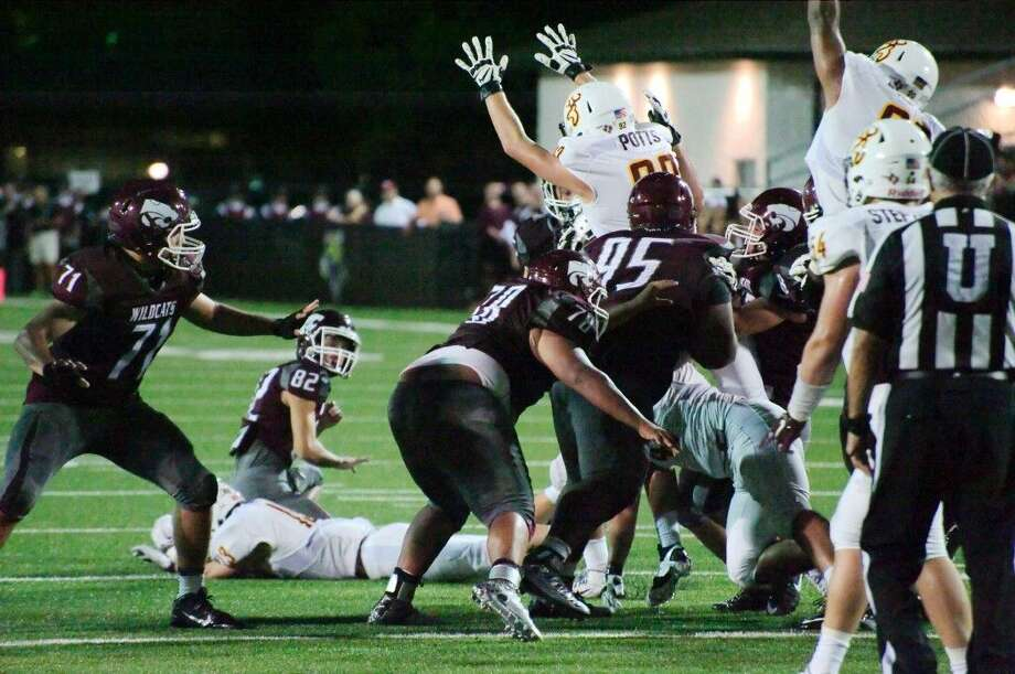 Deer Park's Parker Potts, shown trying to block a Clear Creek PAT score last week, will be attempting to send he and his teammates into 21-6A play with the proper sendoff when they host the War Eagles Friday night. Photo: Kirk Sides