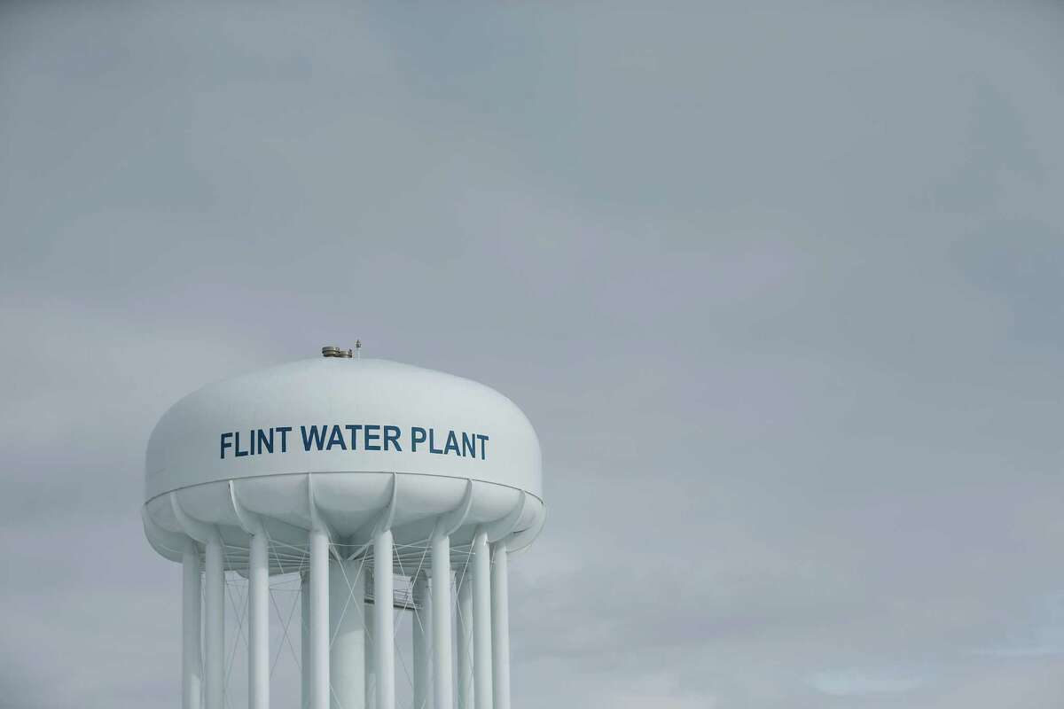 FILE - In this Feb. 26, 2016 file photo the Flint Water Plant tower is seen in Flint Mich. Emails obtained by The Associated Press show EPA chief Gina McCarthy warned in September that the Flint water crisis could