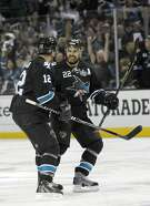 San Jose Sharks defenseman Dan Boyle (22) celebrates with  center Patrick Marleau (12) after scoring a goal against Los Angeles Kings  during the first period in Game 3 of their second-round NHL hockey Stanley Cup playoff series, Saturday, May 18, 2013, in San Jose, Calif. (AP Photo/Tony Avelar)