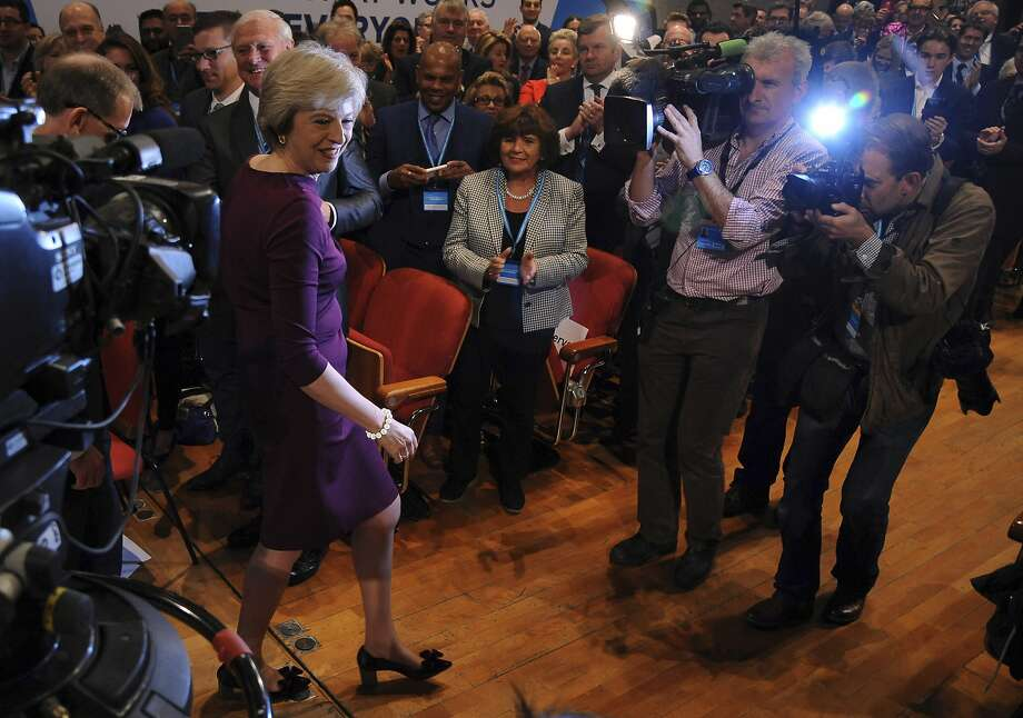 British Prime Minister Theresa May says she will invoke the terms of the EU treaty to start talks on the exit by March. Photo: Rui Vieira, Associated Press