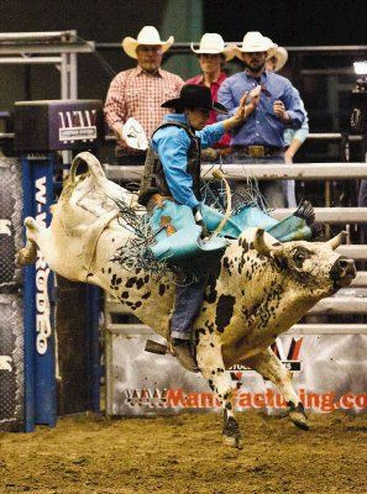 Bull rider Eli Vastbinder, of Statesville, North Carolina, competes during the Champion Bull Riding Conroe Bull Mania at the Lone Star Expo Center Saturday in Conroe, Texas. Go to HCNpics.com to view more photos from the event.