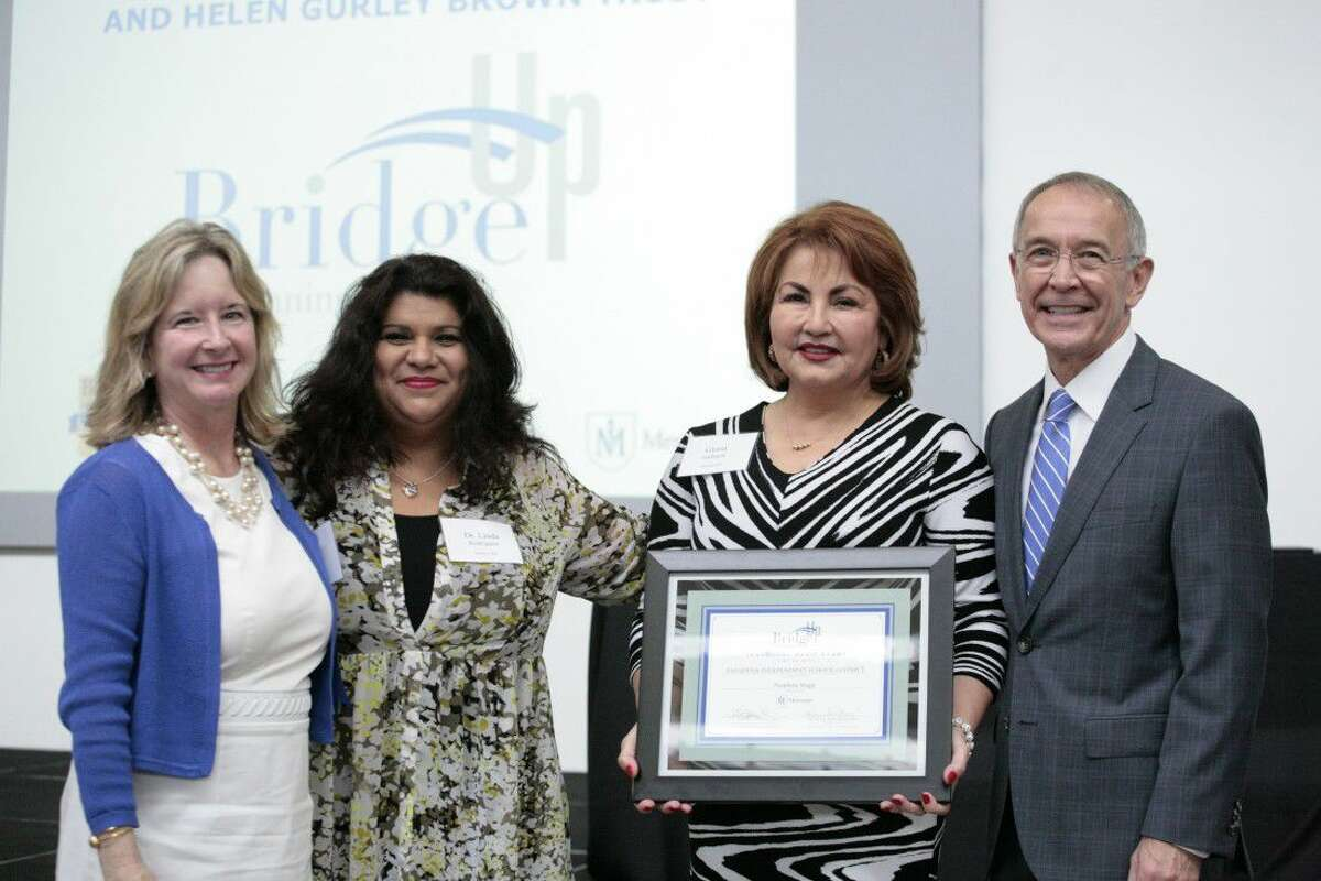 From left - Patricia Gail Bray, Ph.D., director of BridgeUp at Menninger present Linda Rodriguez, Ph.D. and Gloria Gallegos of Pasadena ISD a certificate acknowledging that Pasadena ISD is an inaugural BridgeUp at Menninger grant recipient. Dr. C. Edward Coffey, president and CEO of The Menninger Clinic, applauded their collaborative approach, adding that BridgeUp at Menninger is a unique opportunity to blend best practices in academics with best practices in mental health to ensure that youth become healthy, productive adolescents who thrive. (Photo Credit: John R. Lewis).