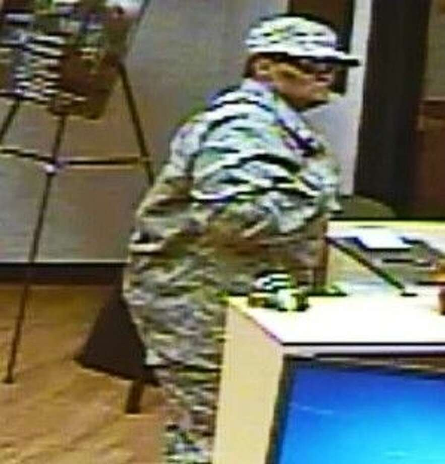 The robber is described as a Hispanic or light complexion Black male or female. The robber was wearing a camouflage hat, black sunglasses, camouflage fatigue shirt, camouflage fatigue pants and white tennis shoes.