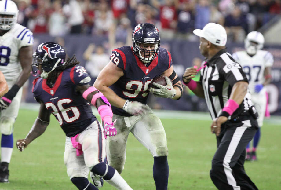 Houston Texans J. J. Watt runs back a fumble for a touchdown against the Indianapolis Colts at NRG Stadium in Houston, Texas on Thurday, October 9, 2014. Photo: Staff Photo By Alan Warren