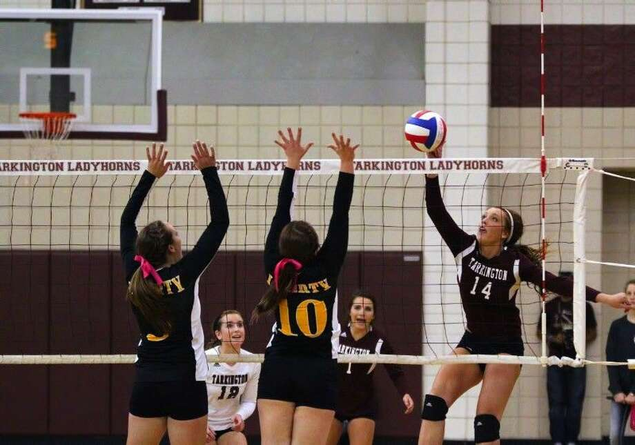 Tarkington's Anna Anderson (14) attacks the net against Liberty's Kaitlyn Slack (3) and Andee Geter (10) Oct. 7, 2014. Photo: Sean Ashley Jones