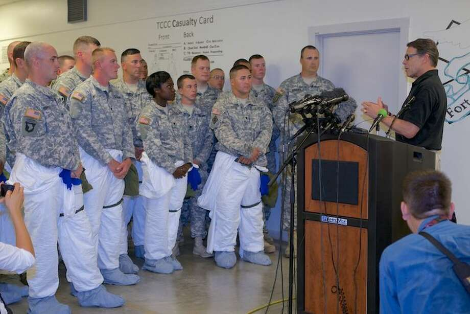 Gov. Rick Perry today visited U.S. Army troops preparing to deploy to the West African nation of Liberia to help combat the spread of Ebola. The U.S. Centers for Disease Control calls this epidemic in West Africa the largest Ebola outbreak in history. Photo: Governor's Press Office