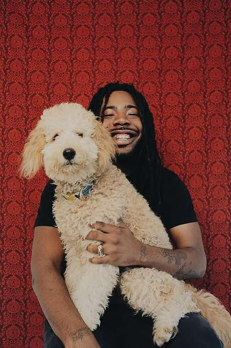 D.R.A.M., seen here with his trademark grin and his dog, is scheduled to perform at 1015 Folsom on Thursday, Oct. 13. Photo: Faye Webster, Courtesy