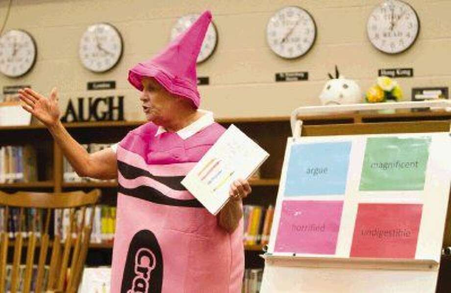 "Conroe ISD Health Coordnator Sharon Sterchy prepares to read ""The Day The Crayons Quit"" at Wilkinson Elementary Wednesday."