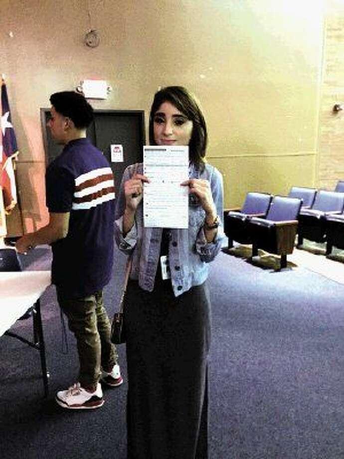Zahely Estrada, 18, a senior at Aldine High School, prepares to register to vote.