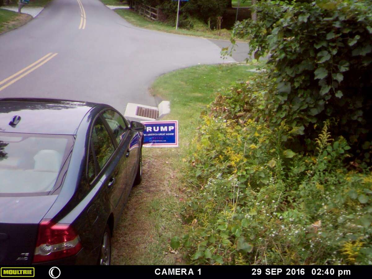 Captured stills from surveillance camera of Trump signs being vandalized from Sept. 26-Oct. 1, 2016.