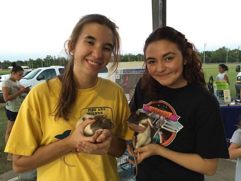 Liberty High School volunteers Camilla Brady and Christina Martinez show off educational rats, Dottie and Coco, at National Night Out on Tuesday, Oct. 7. Photo: Submitted