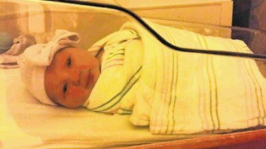 In this July 11, 2014 photo, one-day-old Lucy Ridgway, born at Memorial Hermann The Woodlands Hospital on July 10, 2014, looks toward the camera as her picture is taken.