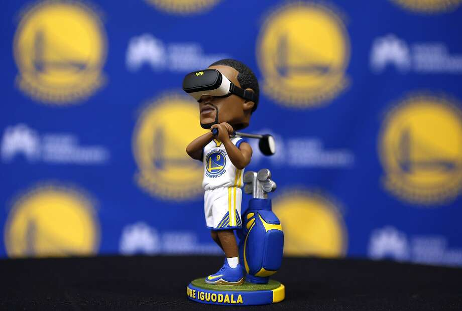 An Andre Iguodala bobble head wearing virtual reality goggles and swinging a golf club is displayed at the Warriors practice facility in Oakland, Calif. on Wednesday, Oct. 5, 2016. The bobble head will be one of the premium giveaways at one of this season's home game. Photo: Paul Chinn, The Chronicle
