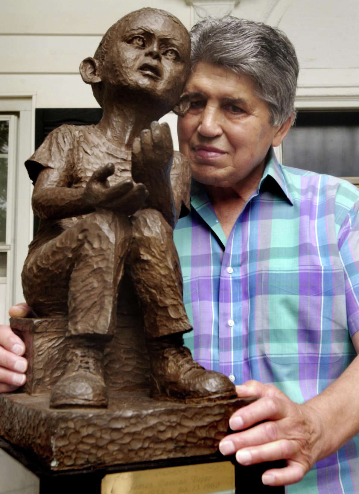 Chico Vejar, a former middleweight boxing contender from Stamford, visits the David G. Osterer Cerebral Palsy Center in Rye Brook, N.Y., where he founded the Jimmy Vejar Day Camp in honor of his son, who died from cerebral palsy. Jimmy is memorialized in the sculpture.