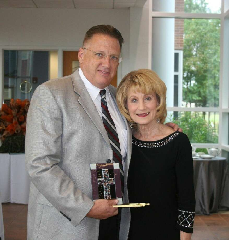 Pam Dickson presented Kroger Corporate Executive Tom Truver with the Joe Boyd Community Service Award at the annual Mission Northeast luncheon and fashion show on Oct. 6. Photo: Staff Photo By Stephanie Buckner