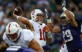 SEATTLE, WA - SEPTEMBER 30:  Quarterback Keller Chryst #10 of the Stanford Cardinal is hit as he throws by linebacker Connor O'Brien #29 of the Washington Huskies on September 30, 2016 at Husky Stadium in Seattle, Washington.  (Photo by Otto Greule Jr/Getty Images)