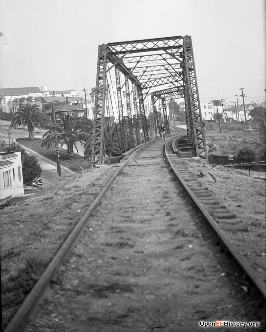 27th and Dolores circa 1937, SF & San Jose RR Trestle, Photographer Mr. Manning on trestle tracks. Courtesy of OpenSFHistory.org.