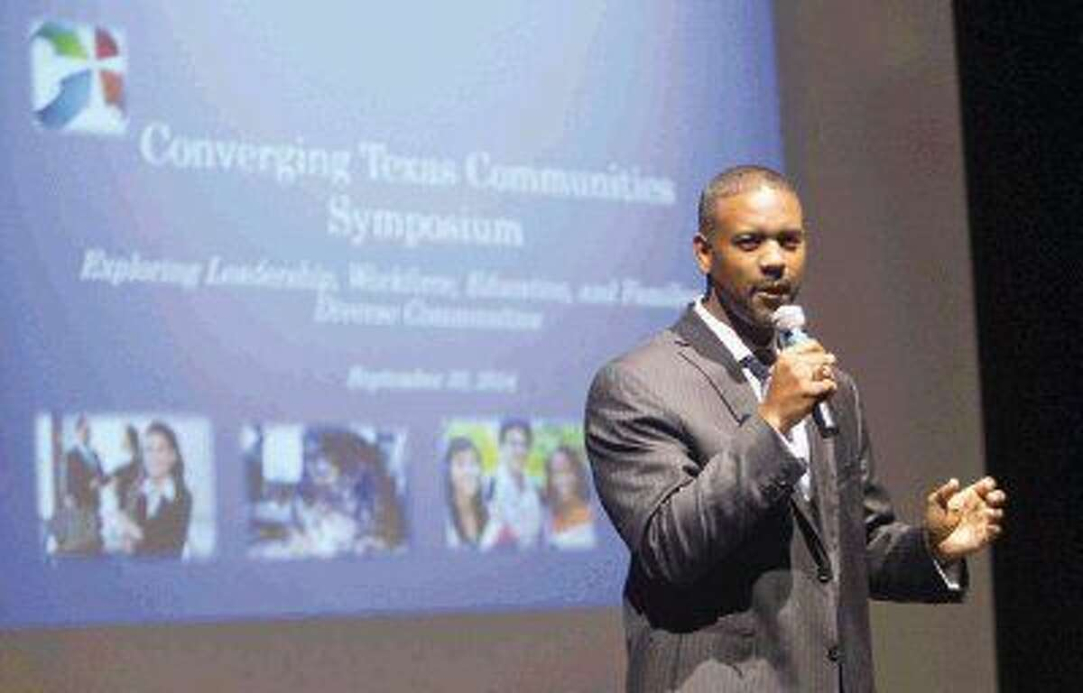 Lone Star College - Montgomery President Austin Lane speaks during the Converging Texas Communities Symposium at Lone Star College - Montgomery Tuesday. The symposium focused on exploring diversity in leadership, education, family and the workforce.