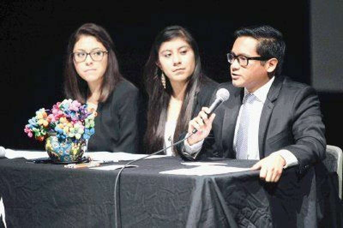 Arnulfo Carrillo answers a panel question as fellow student speakers Daniela Gonzalez and Viviana Duran look on during the Converging Texas Communities Symposium at Lone Star College - Montgomery Tuesday. The symposium focused on exploring diversity in leadership, education, family and the workforce.