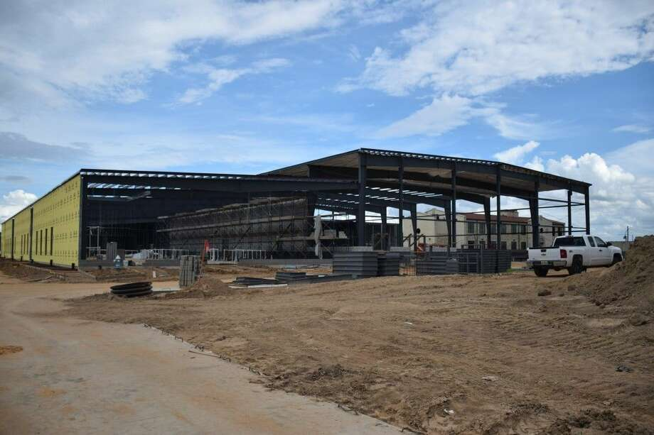 Construction continues on Frassati Catholic High School's new gymnasium/fine arts building. Workers have erected the frame, begun the exterior walls and completed two new school parking lots. Photo: Submitted Photo