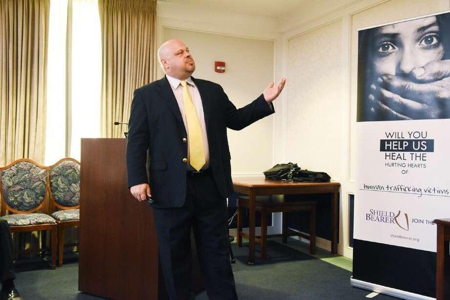 Sheild Bearer Executive Director Roy Wooten speaks about human trafficking. Photo: Photographer