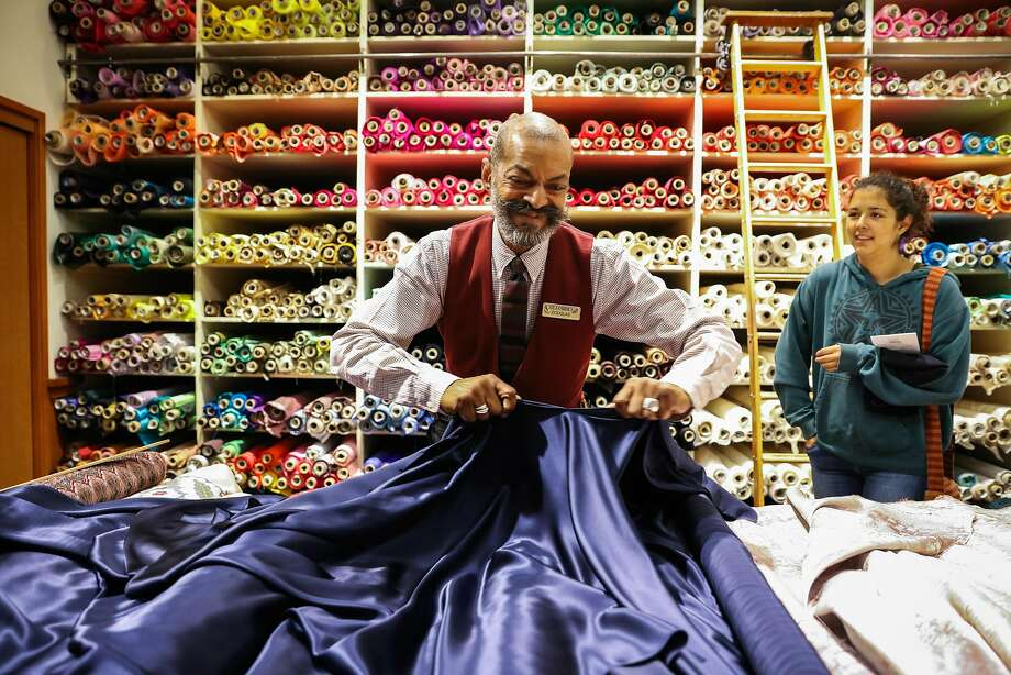 Employee Douglas Davis (left) helps student Sara Scott (right), who has regularly shopped at Britex for three years, buy fabric, at Britex Fabrics, in San Francisco, California, on Wednesday, Oct. 5, 2016. Photo: Gabrielle Lurie, The Chronicle