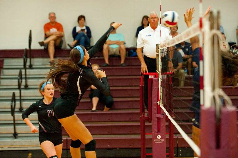 Magnolia senior Morgan Miller goes up for one of her 38 kills against Tomball Memorial in a 3-2 victory on Tuesday, October 7.