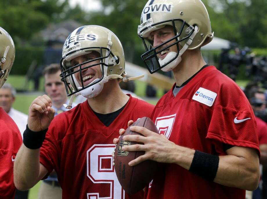 New Orleans Saints quarterback Drew Brees, left, will be sidelined for New Orleans' game at Carolina on Sunday.
