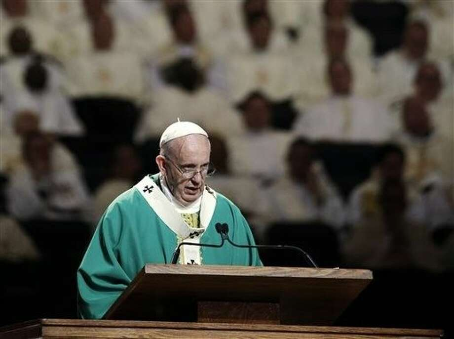 Pope Francis reads his homily while celebrating high Mass at Madison Square Garden, Friday in New York. Photo: Julie Jacobson