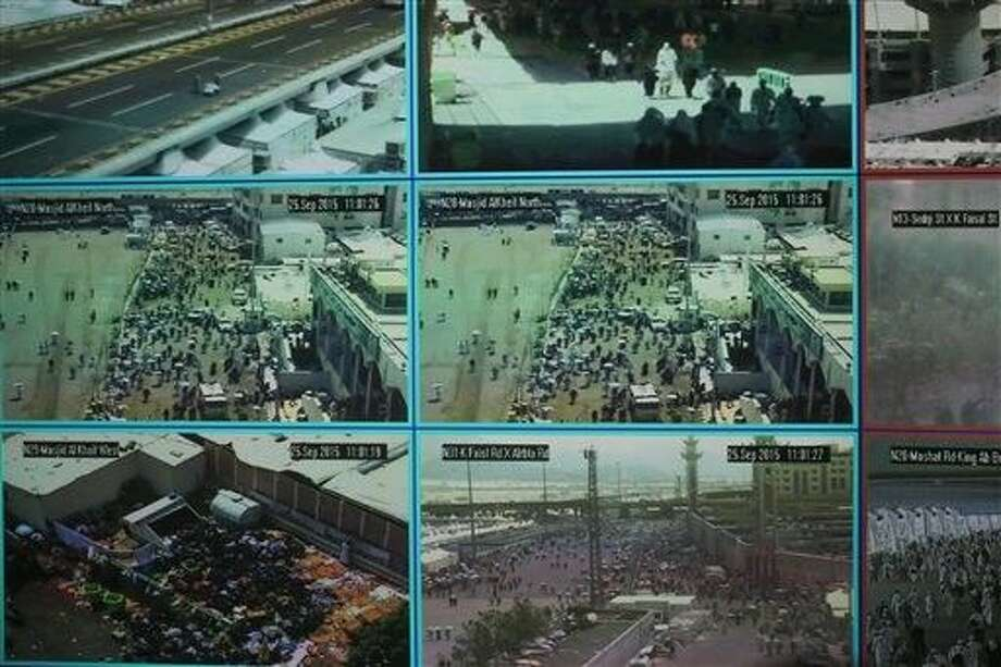 Muslim pilgrims attending the annual hajj pilgrimage are monitored on CCTV screens at a security command center in Mina, Saudi Arabia, on Friday a day after a stampede killed more than 700 people. Photo: Mosa'ab Elshamy